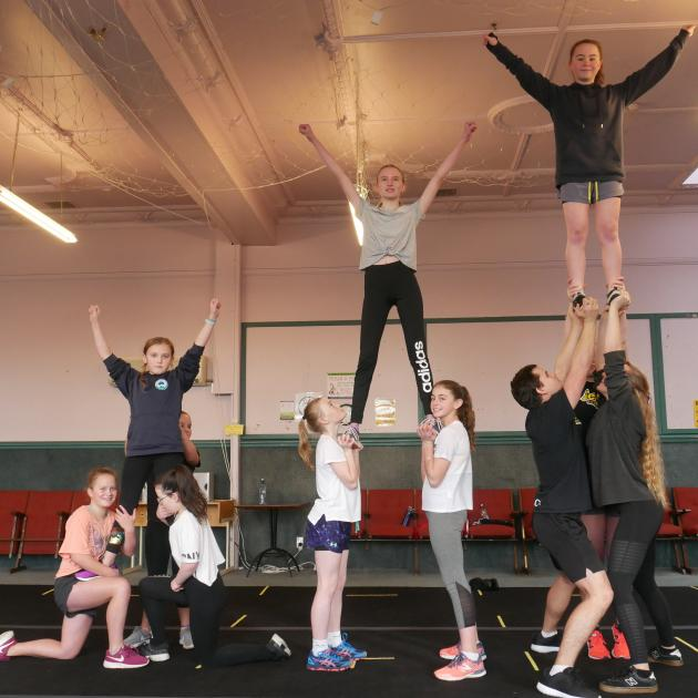 Eclipse Cheerleading athletes form pyramids at  practice last month. PHOTO: JESSICA WILSON