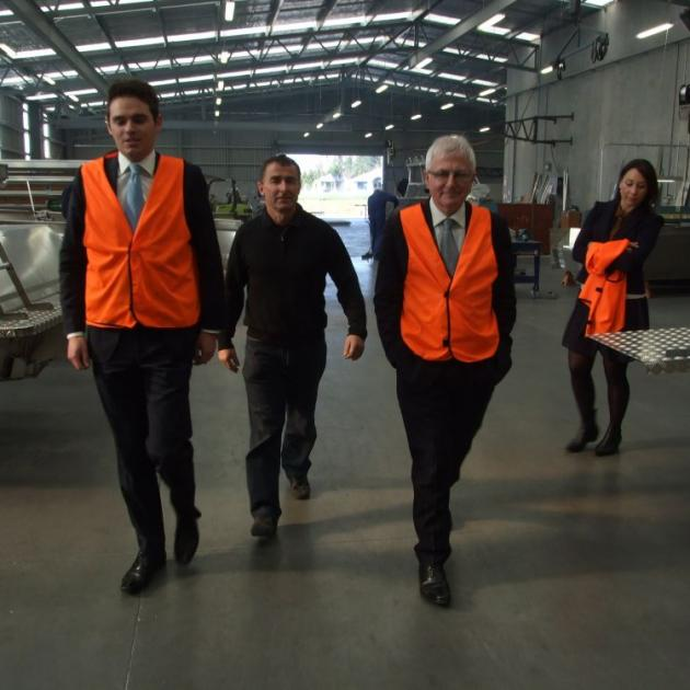 Visiting the McLay Boats warehouse in Milton, yesterday, are (from left) National candidate Todd Barclay, business owner Steve McLay, Trade Minister Tim Groser and National Pparty staffer Fleur Thompson. The manufacturer exports 40% of its boats. Photo by