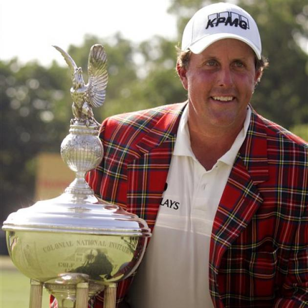 Phil Mickelson poses with the Marvin Leonard trophy after winning the Colonial golf tournament in...
