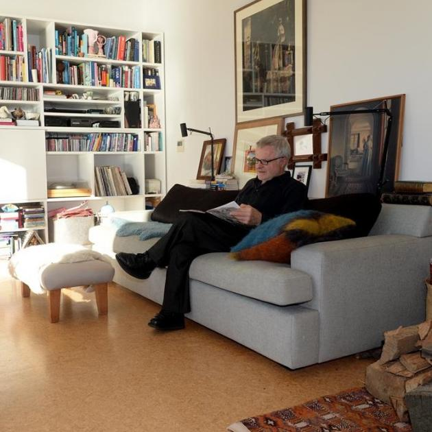 Rhodes Donald relaxes with a book in the living area. Photo: Linda Robertson