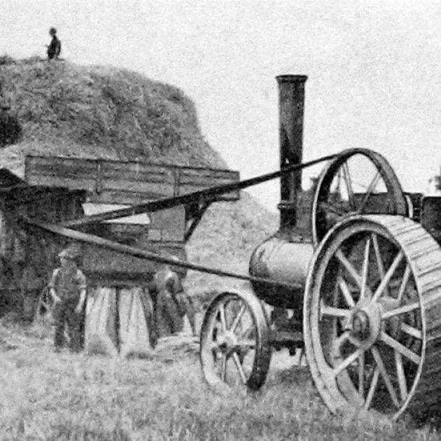 A threshing mill, powered by a traction engine, at work in a harvest field. — Otago Witness, 9.8...