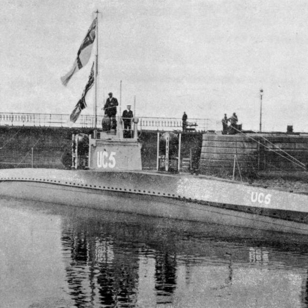 A captured German mine-laying submarine of the latest type in the dockyard basin at Temple Pier,...