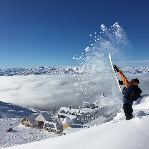 A snowboarder flicks up powder snow at the Cardrona Alpine Resort earlier this season. Photo:...