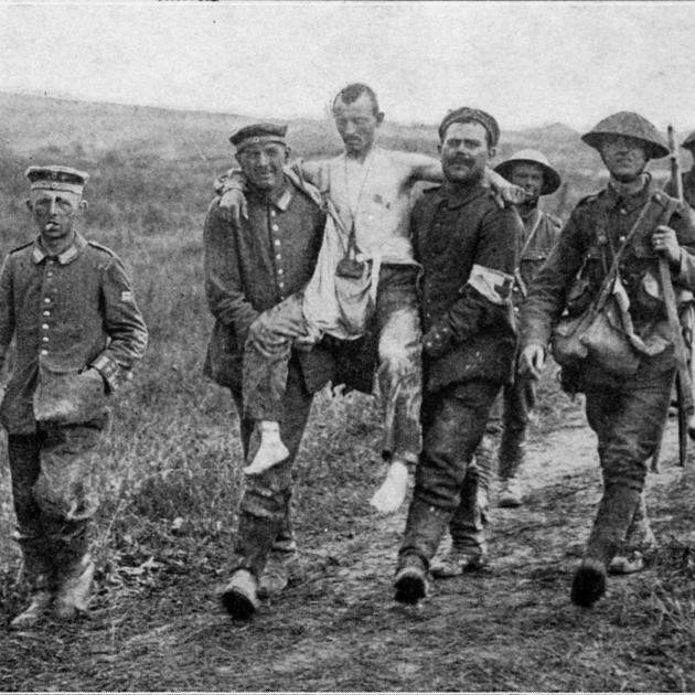 German prisoners carrying their wounded to the rear of the Allied lines in France.
