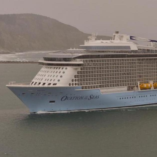 Ovation of the Seas passes through the heads of the harbour on its way to Port Chalmers earlier...