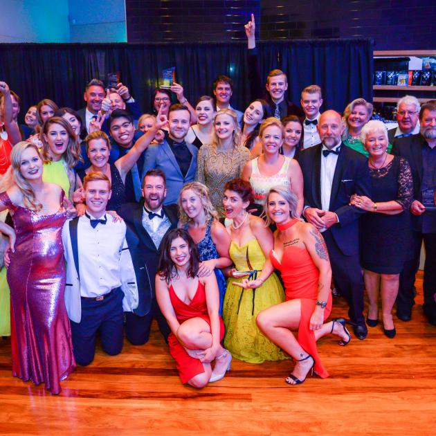 The cast and crew of Grease: The Arena Spectacular Live celebrate at the Otago Southland Theatre...
