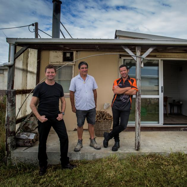 Visiting the late Hone Tuwhare's crib at Kaka Point are (left) television presenter and architect...