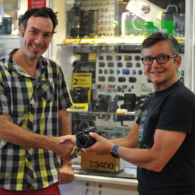 Magic Moments 2017 winner Stu Hardisty (left) collected his first place prize. Photo: Christine O...