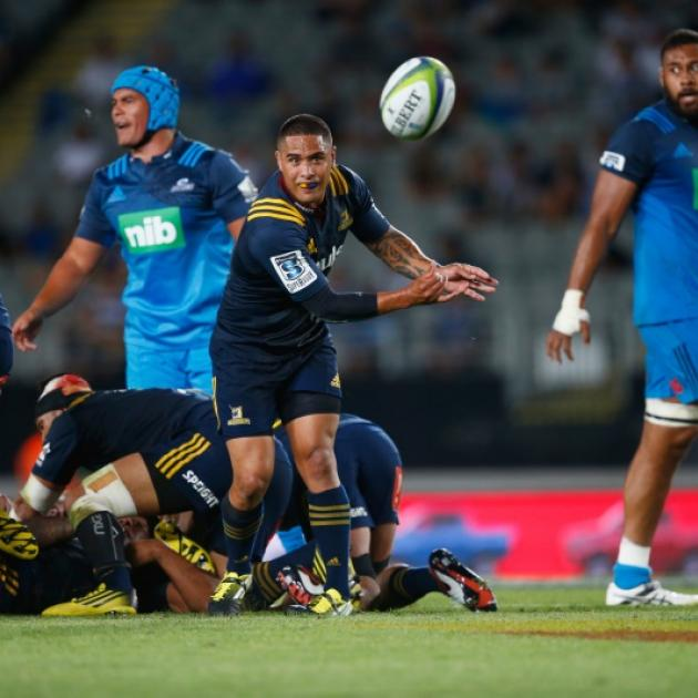 Aaron Smith clears the ball from the ruck for the Highlanders against the Blues. Photo: Getty Images