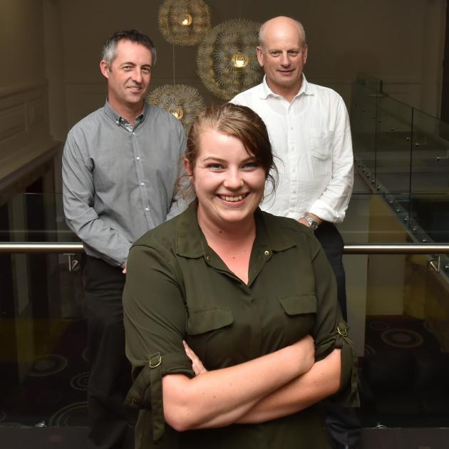 Otago Polytechnic student Ashley Hart has been working with AbacusBio consultants Simon Glennie (left) and Bruce McCorkindale on her research project about farm succession. Photo by Gregor Richardson.