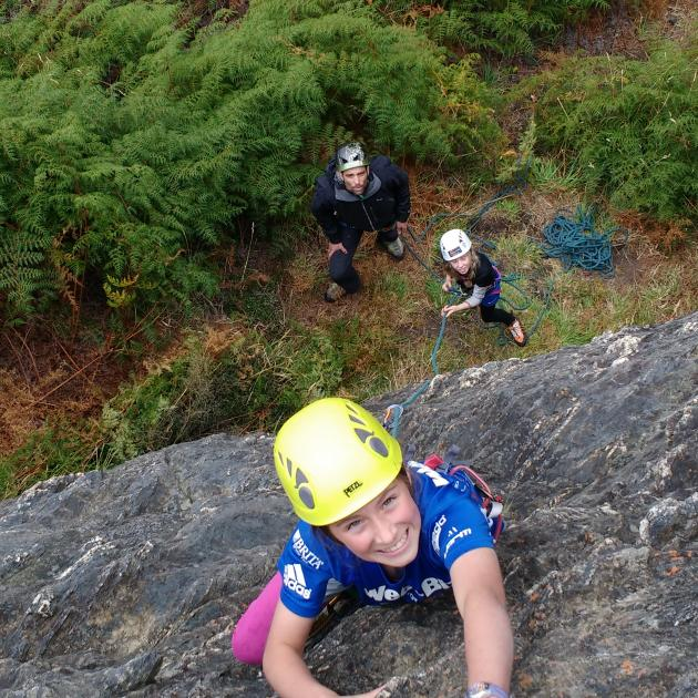 Azaria Briscoe (11) scales a rock face at Wye Creek while Harry Thomas (13) and instructor...