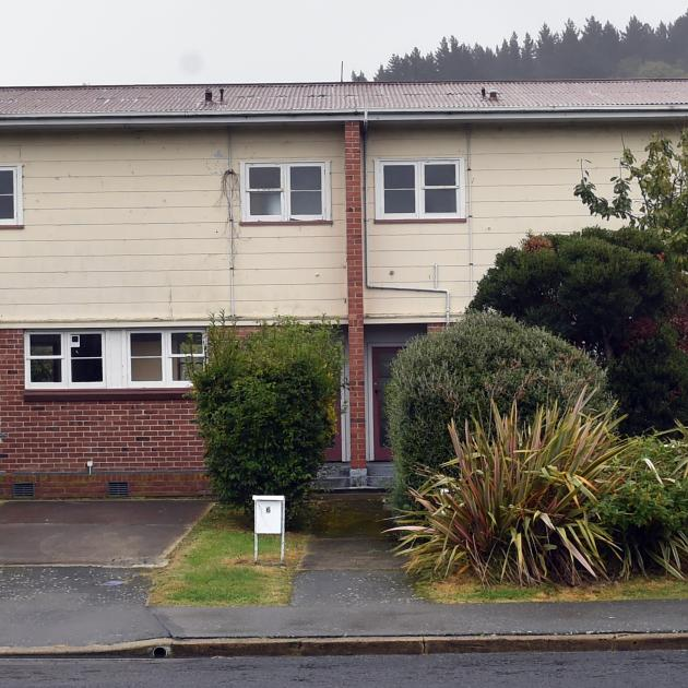 This block of three houses in Albertson Ave, Port Chalmers, is among the empty Housing New...