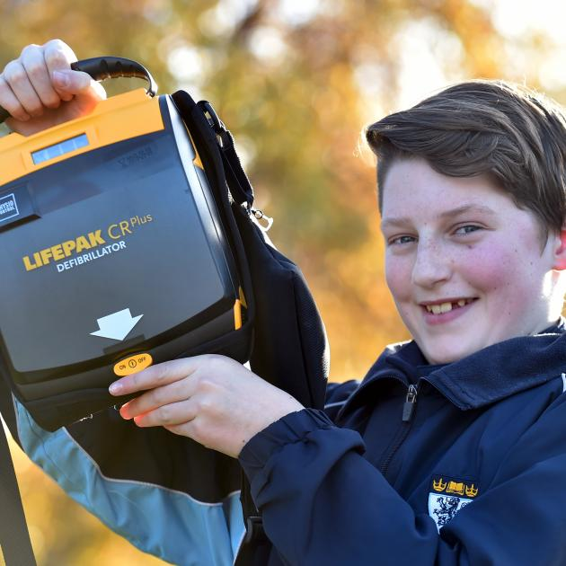 King's High School year 9 pupil Jaimin Armstrong with the school's new defibrillator. Photo:...