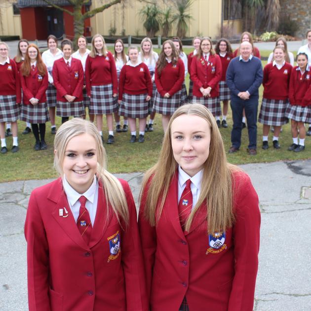 Dunstan High School Senior Girls' Choir leaders Dana Jenkins (18, left) and Holly Taucher (18)...