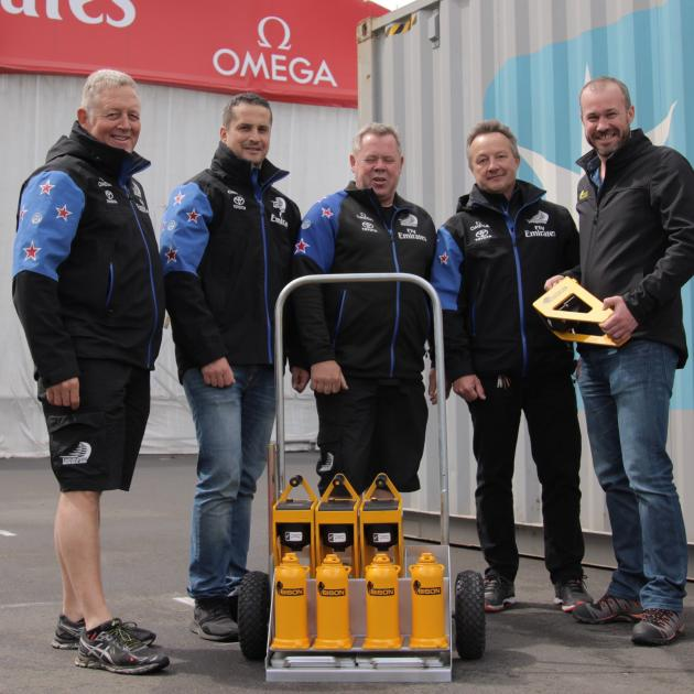 Bison chief executive Greg Fahey (right) delivers a set of Bison C-Jacks to Emirates Team New...