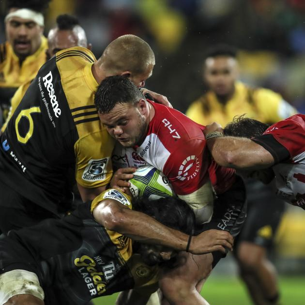 Dylan Smith of the Lions is tackled. Photo: Getty