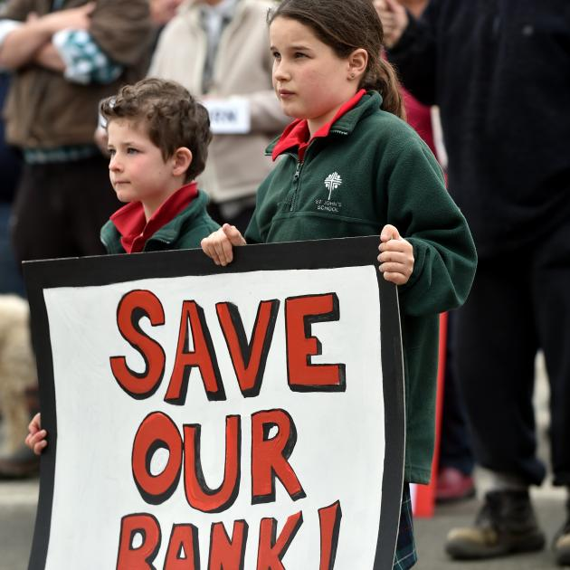 Stuart HoreBen (6) and Ella (10) Gibson, of Ranfurly, protest against Westpac's closure of the ...