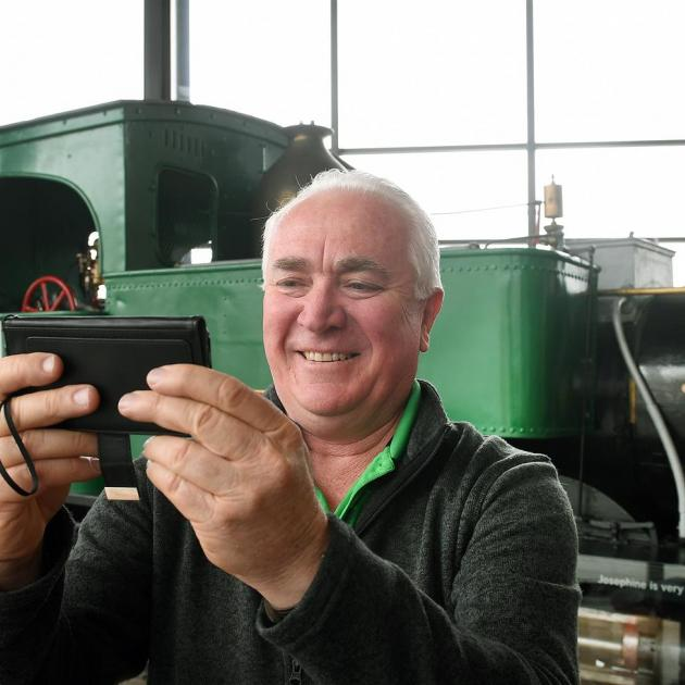 Peter Gatwood (61), of Australia, takes a photo of himself in front of Josephine, on which his...