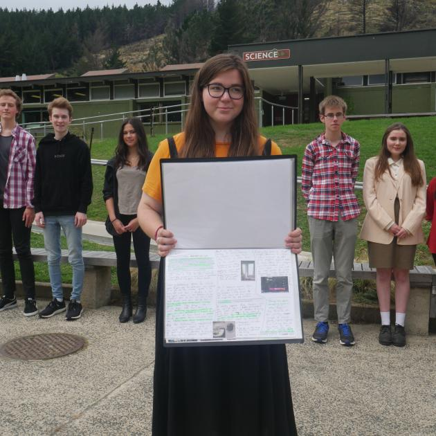 Former Logan Park High School pupil Isla Thomas (18) shows off the photography workbook she...
