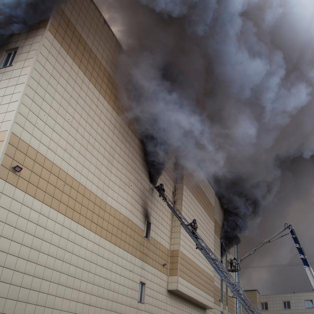 "The fire swept through the upper floors of the ""Winter Cherry"" shopping centre where a cinema complex and children's play area were located. Photo: Reuters"