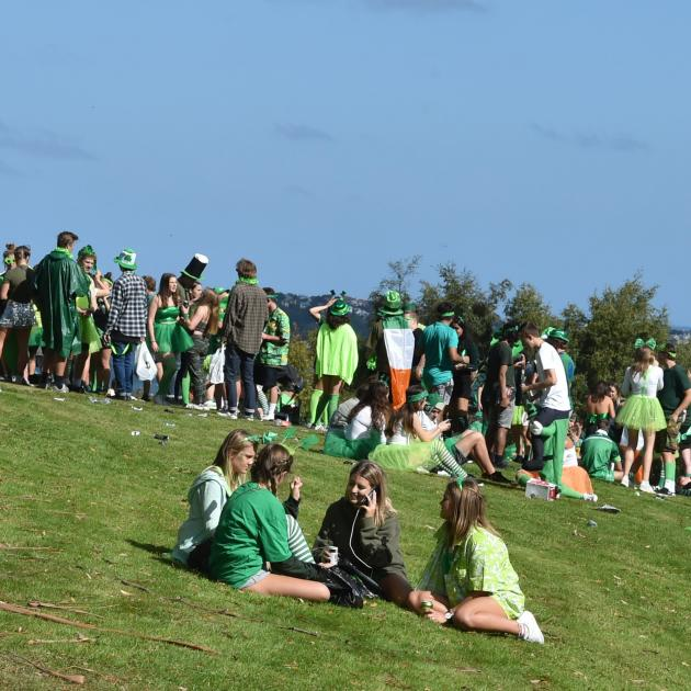 A crowd of about 300 people, mostly students, enjoy the sunshine as they party at Bracken View in...