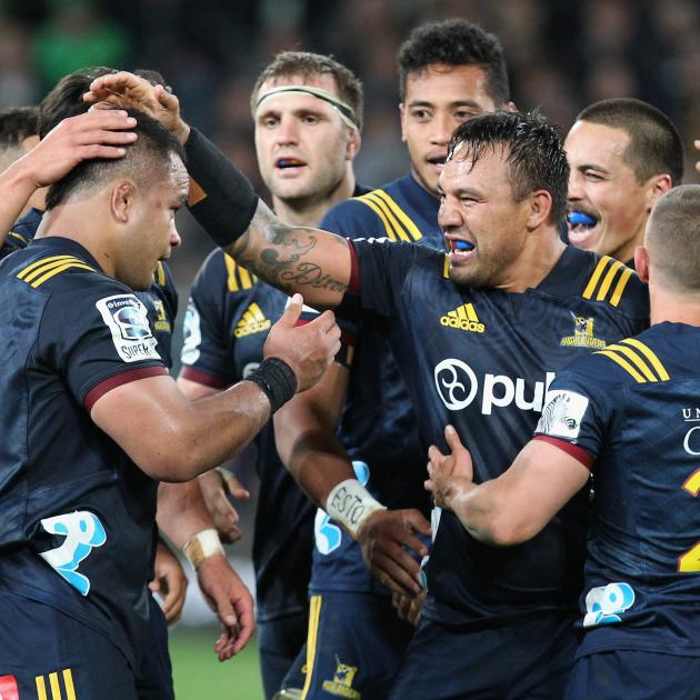 The Highlanders forward pack celebrate a job well-done over a much lauded Crusaders pack. Photo:...