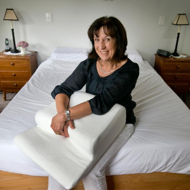 Former Dunedin woman Frances Anderson with the Patney sleep positioner she has invented. Photo:...