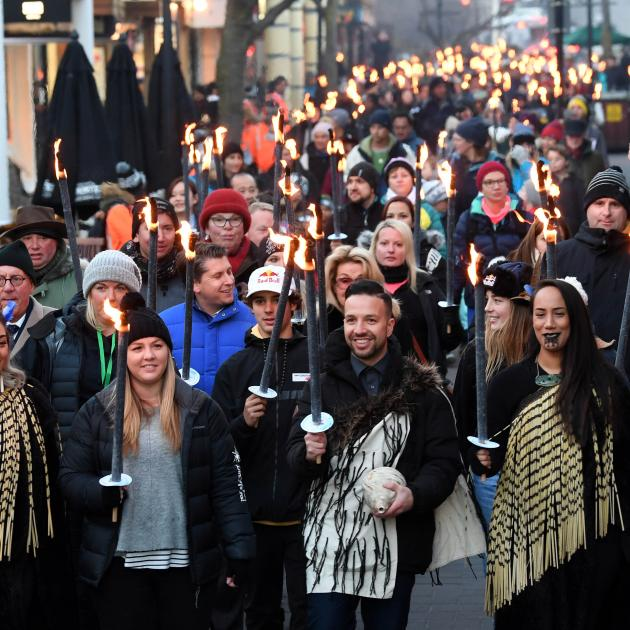 Leading the Matariki Torchlight Procession along Queenstown Mall to the waterfront are (from left...