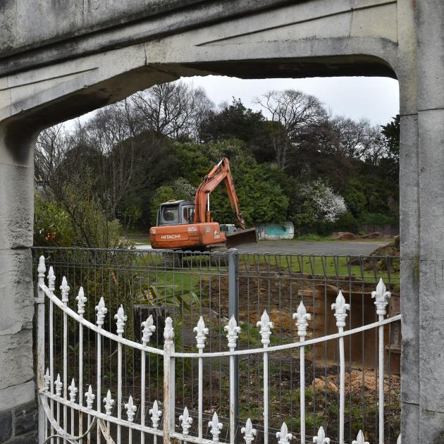 A contractor scrapes back the topsoil at the former site of the High Street School yesterday, so...