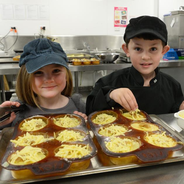 Budding cooks Abigail Roach (5) and and Leo Branford (7), both of Dunedin, practise their...