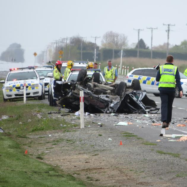 Police at the scene of a crash near Ashburton which killed two people this afternoon. Photo: John...