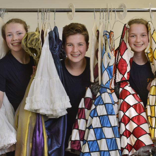 Dunedin dancers Lucy Woodhouse (14), Harry Easton and Victoria Avery (both 13) amid the costumes...