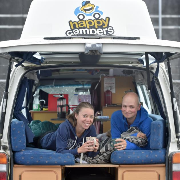 German tourists Rahel (left) and Jan enjoy a hot drink at the Thomas Burns St freedom camping...