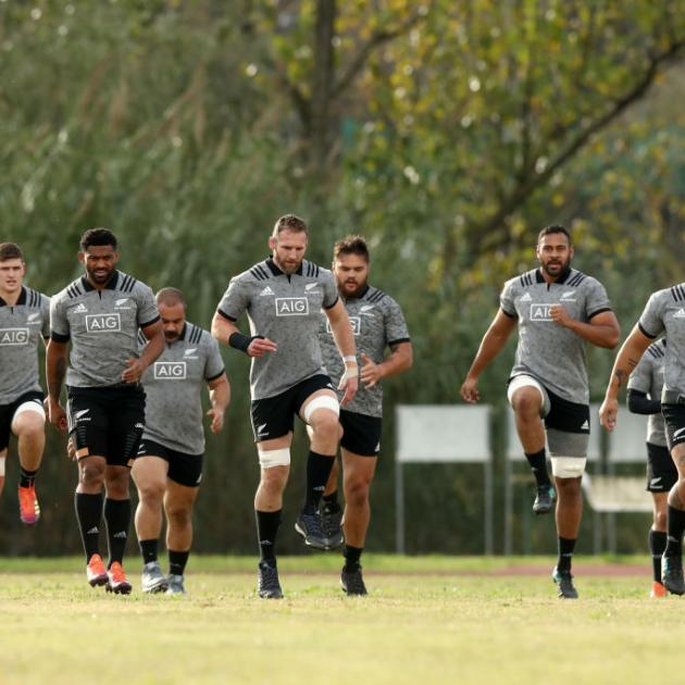 All Blacks squad members warm up before a training session in Rome this week. Photo: Getty