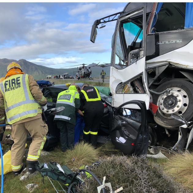 Emergency services staff work at the scene of a fatal collision near Kingston yesterday. Photo: Supplied