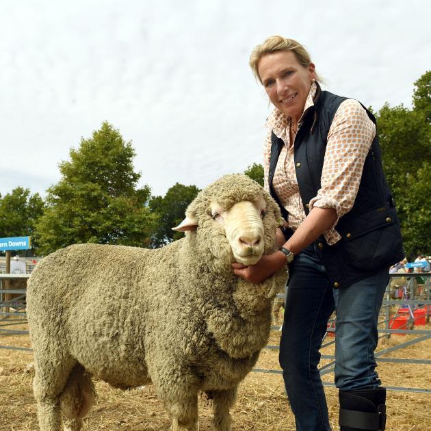 Georgie Wallace, of Tasmania, with the supreme champion sheep at the Wanaka A&P Show, a merino...