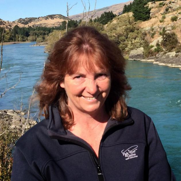 Otago Fish and Game councillor Vicky White is flanked by the Clutha River near her home town of...