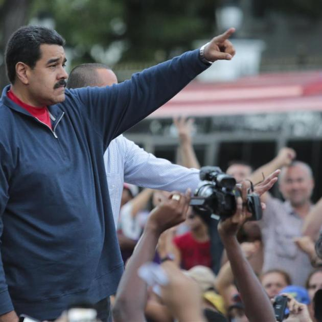 Venezuela's President Nicolas Maduro gestures during a gathering outside Miraflores Palace in...