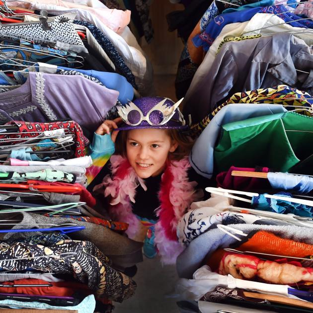Lola Gilks (10), of Dunedin, tries out some of the options at a charity costume auction yesterday...