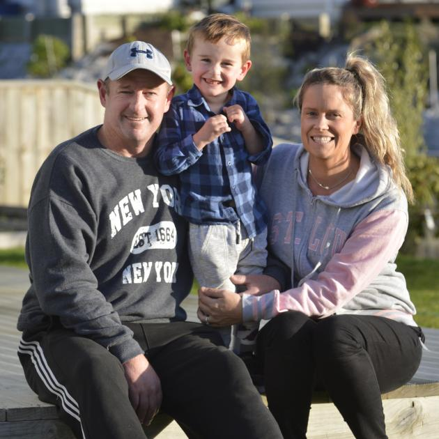 Harry Finch lifts his leg yesterday at his Abbotsford home with parents Hayden and Bex. PHOTO:...