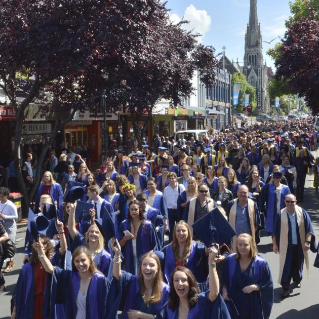 Otago Polytechnic graduands parade up George St. Photo: Gerard O'Brien