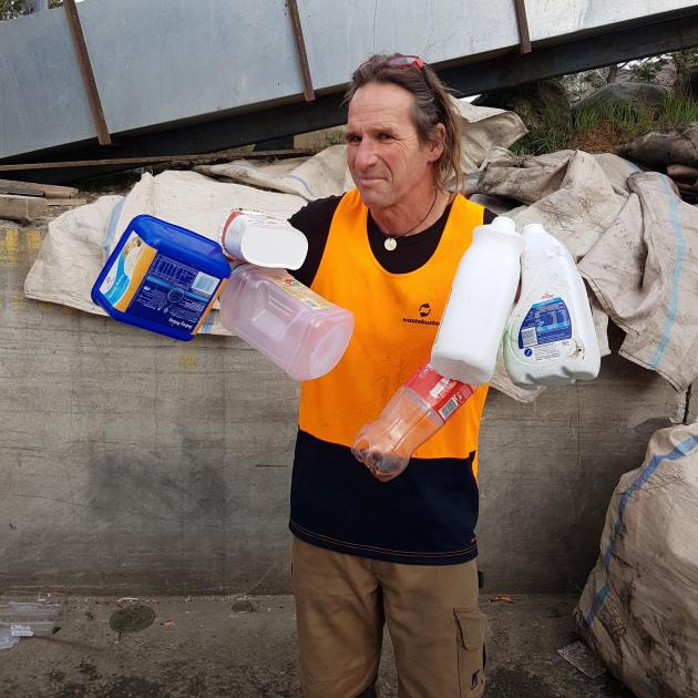 Wastebusters recycling manager Bius Bisson shows some of the plastic containers and bottles 1, 2...