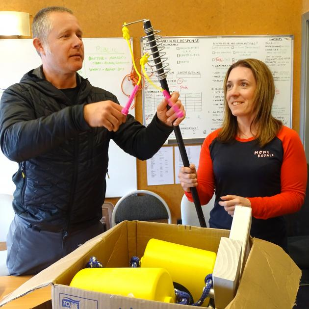 Treble Cone brand manager Richard Birkby helps health and safety officer Jessica Griffin unpack...