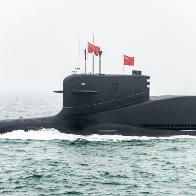 The Jin-B Project 094B ballistic missile submarine takes part in a military parade marking the 70th anniversary of the founding of China's Navy, in the Yellow Sea. Photo: Getty Images