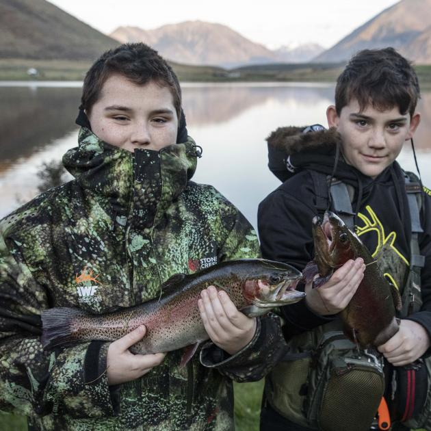 Twins Lleyton and Joshua Rogers with their catch.