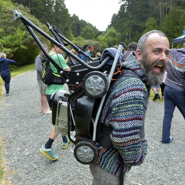 Andrew Glennie carted a lawnmower on his back while completing four laps in the Cargill Crusher...