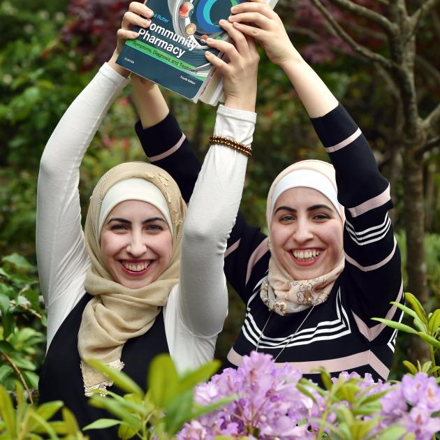Identical twins Dareen and Nadeen Saleem (24) prepare to graduate from the University of Otago...