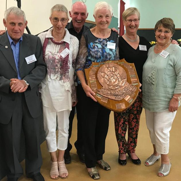 Celebrating their success with Westland Rose Society president Stan Hyde (far left) are North...