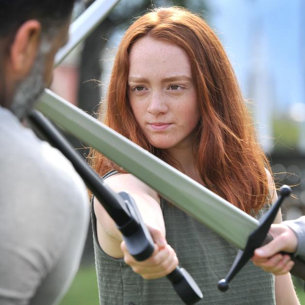 Otago Girls' High School year 12 pupil Sophia Niblock (16) clashes her practice sword with that...