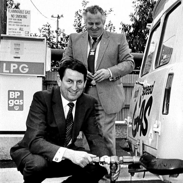 Bill Birch (front), who was the driving force behind Think Big energy projects, poses with...